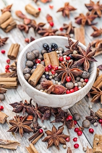 A healthy array of star anise pods, berries, and cinnamon sticks