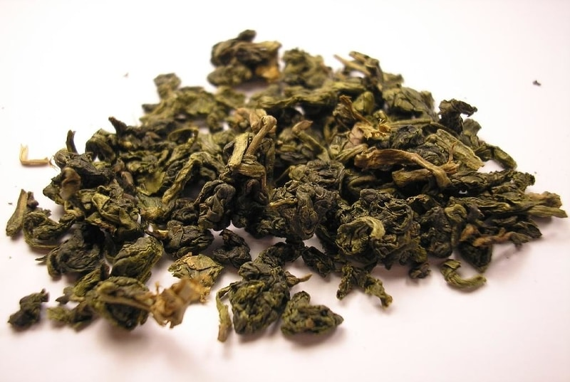 Loose leaf oolong tea resting on a white table