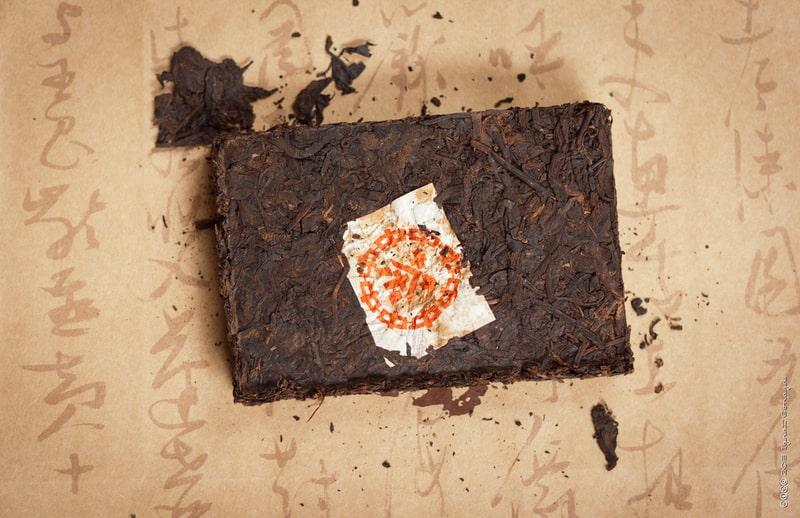 Freshly unwrapped brick of post-fermented pu-erh tea
