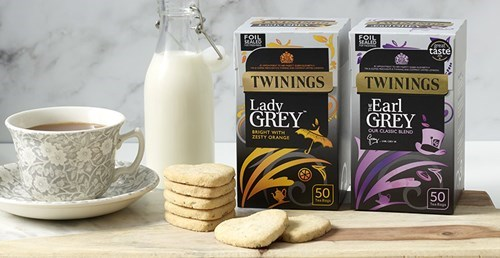 Boxes of Twinings Earl Grey and Lady Grey sitting side by side on a table