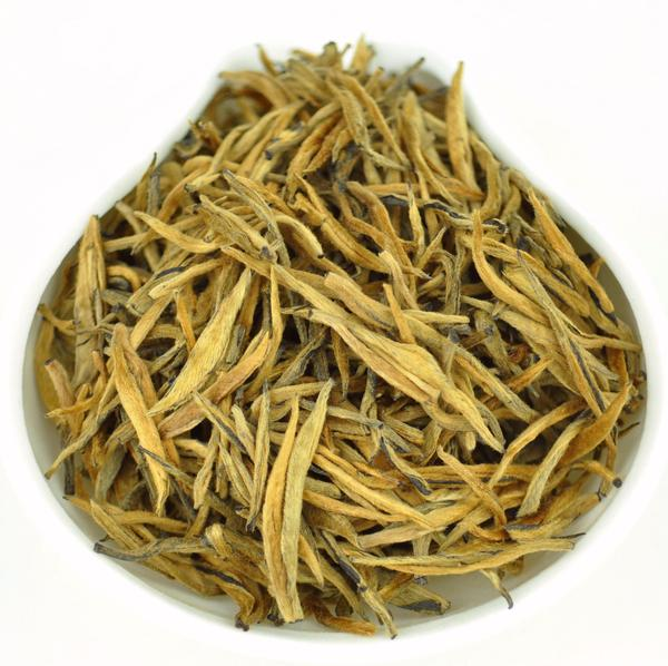 Imperial Gold Needle black tea sitting in a pan